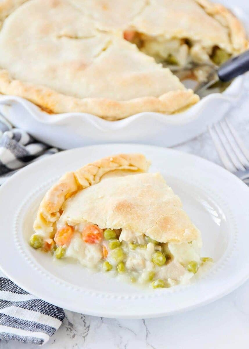 slice of homemade chicken pot pie on a white plate