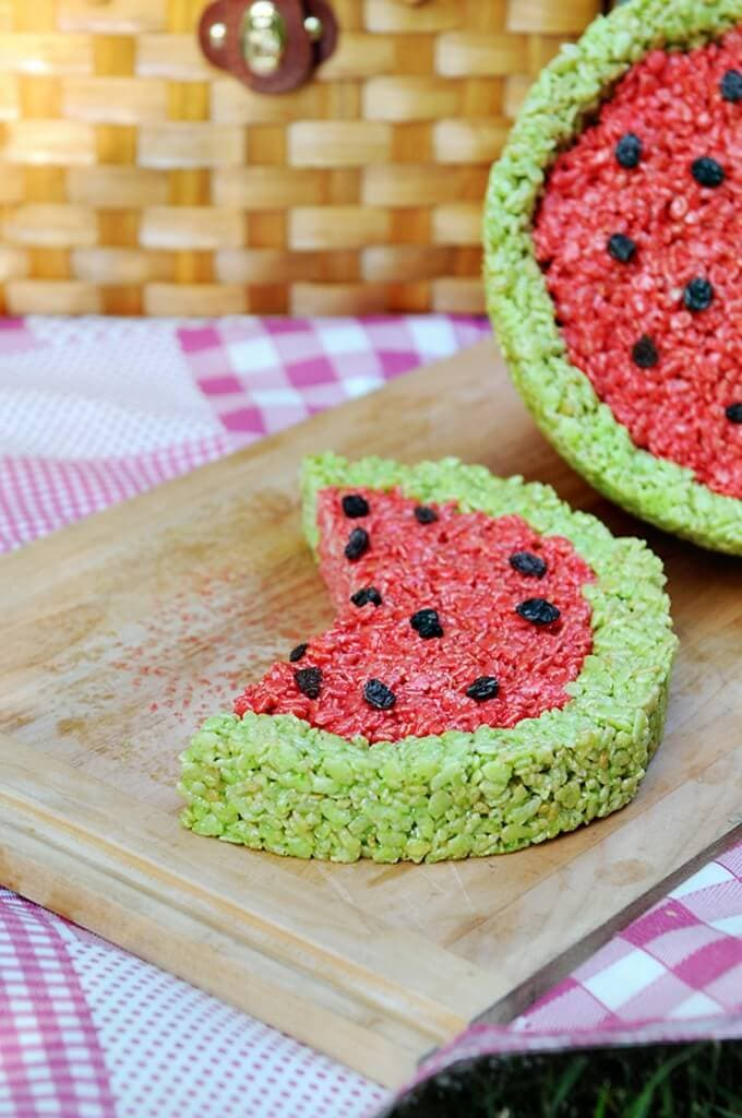 "Tangy Watermelon Rice Krispie Treats + 25 Mouth-Watering Watermelon Desserts...the perfect refreshment that shouts, ""Summertime is here!"""