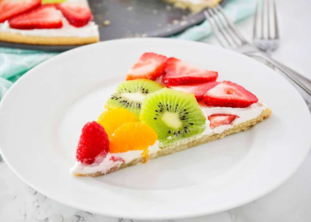 piece of fruit pizza on a white plate