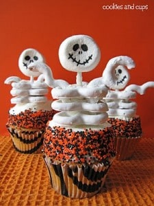 skeleton cupcakes on table