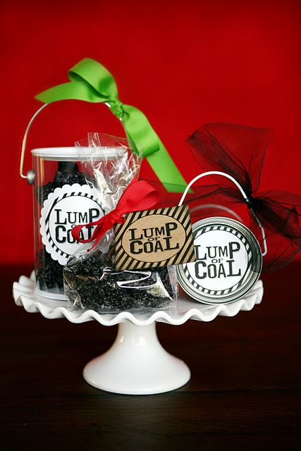 lump of coal gifts on a cake stand
