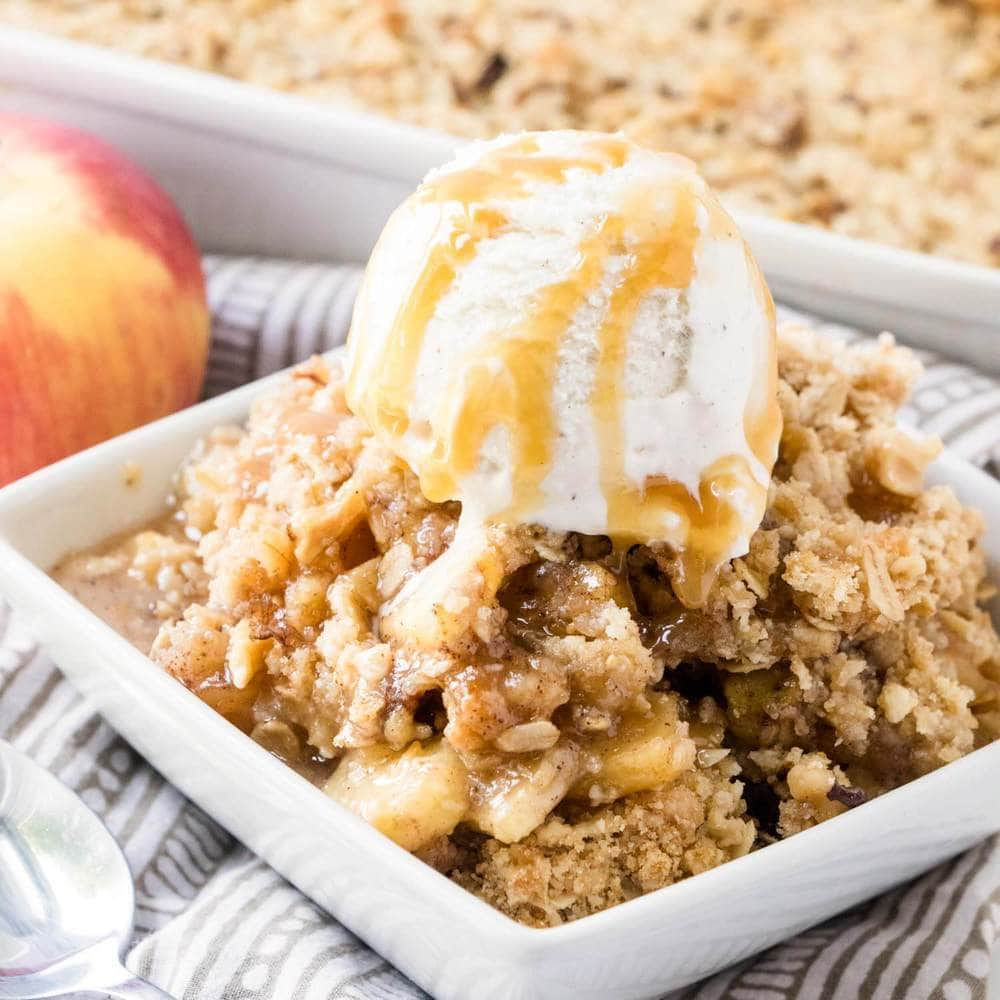 easy apple crisp with ice cream and caramel on top