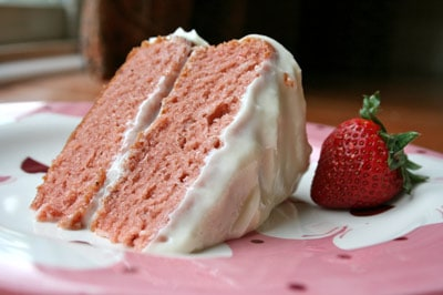 close up of strawberry cake on plate