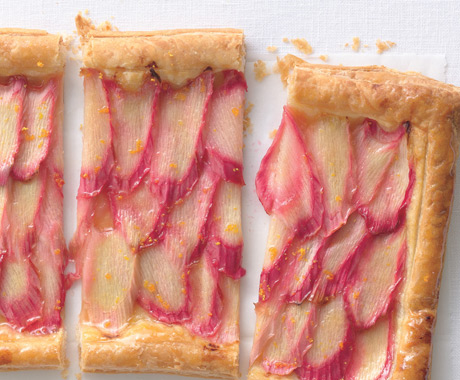 close up of rhubarb tart slices with orange zest