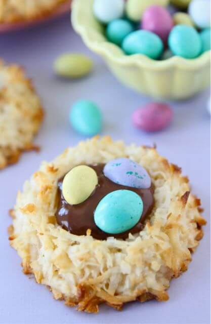 A close up of a coconut macaroon nutella egg nest