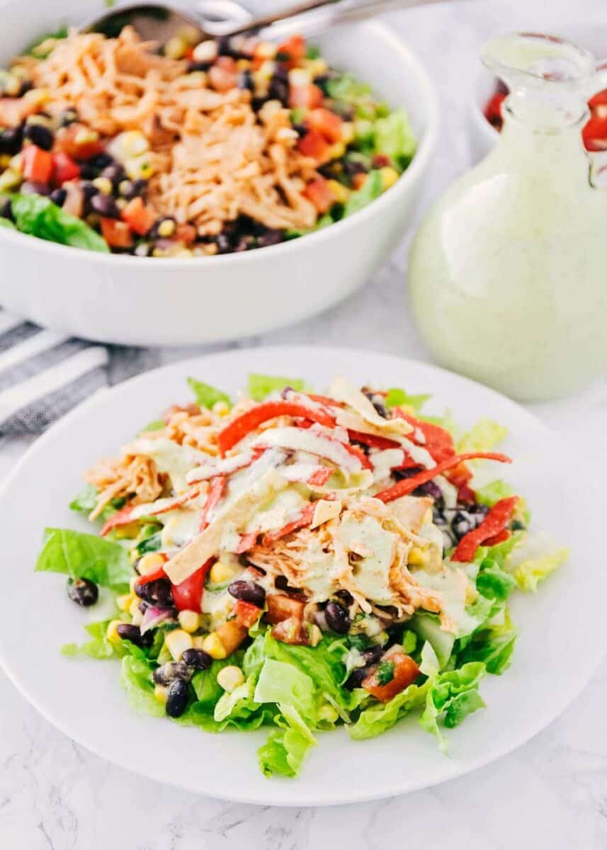 bbq chicken salad recipe on a white plate