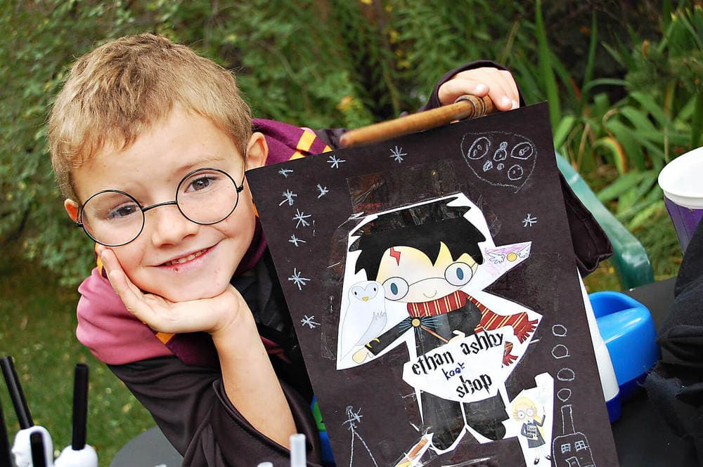 A little boy dressed up as harry potter