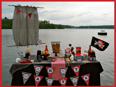 a pirate decorated birthday party table that\'s outside