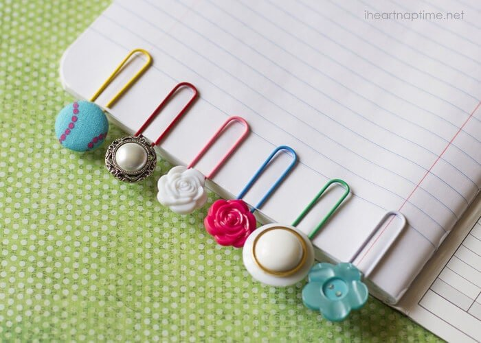 homemade button bookmarks on a notebook