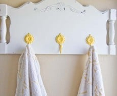 Turn an old headboard into a towel holder or coat hanger. Such a fun DIY project!