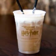 butter beer in a harry potter plastic cup with 2 straws