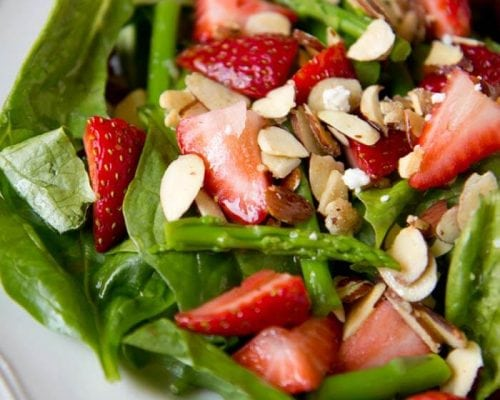 a close up of strawberry asparagus salad