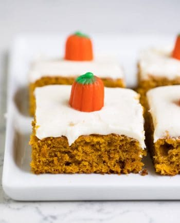 pumpkin bar with cream cheese frosting and a candy pumpkin on top