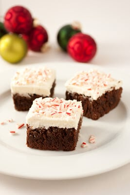 peppermint brownies with buttercream frosting on white plate