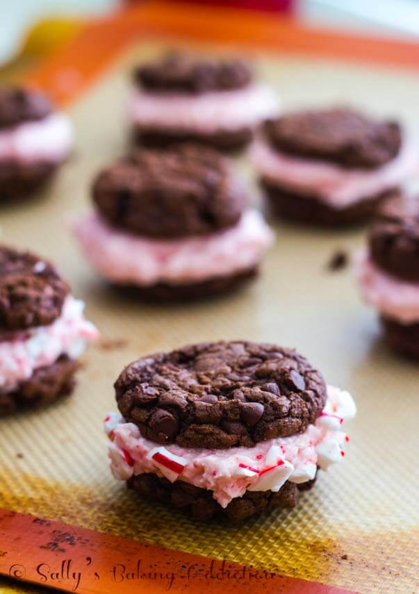 chocolate cookie sandwiches filled with candy cane buttercream on baking sheet