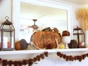 fall mantel with pinecones