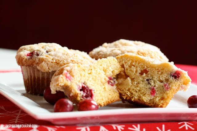 crumb topped cranberry eggnog muffins on white plate