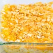 close up of cheesy potatoes in baking dish