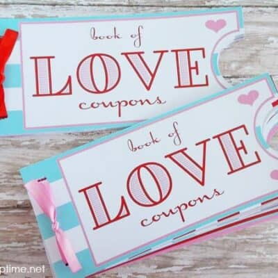A close up of two love coupon books
