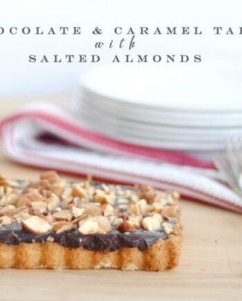 caramel chocolate almond tart on wood table
