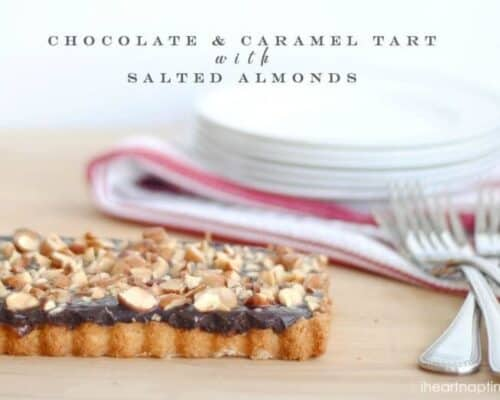 caramel chocolate almond tart on wood table