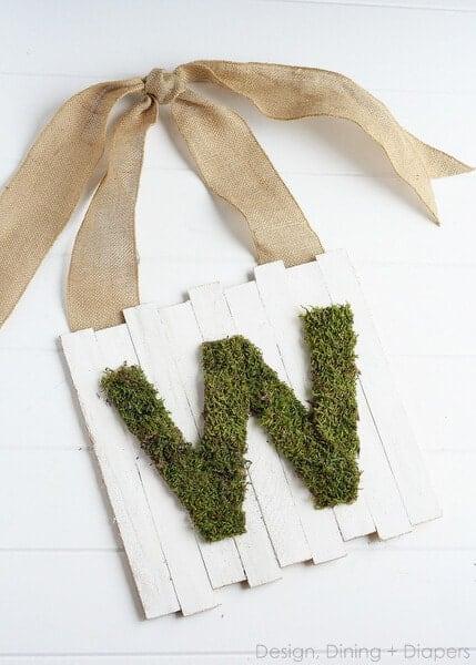 moss wooden pallet letter