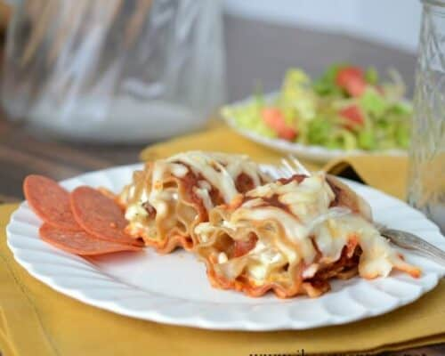 pepperoni pizza lasagna roll ups on white plate