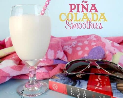 pina colada smoothie in a glass with a straw