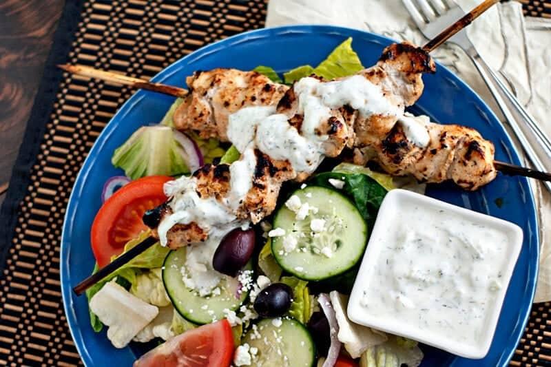 grilled chicken tzatziki salad on blue plate