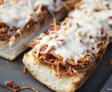 Spaghetti boats ... leftover spaghetti and garlic bread! Easy and delicious!