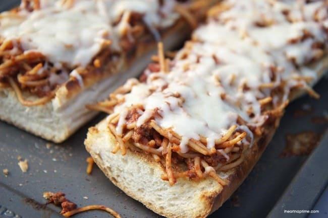 Spaghetti boats ... leftover spaghetti and garlic bread! Easy and delicious!