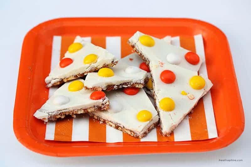 Salted caramel candy corn bark on plate