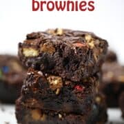 a stack of loaded candy bar brownies