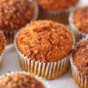 A close up of a pumpkin snickerdoodle muffin