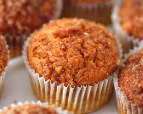 A close up of a pumpkin snickerdoodle muffin