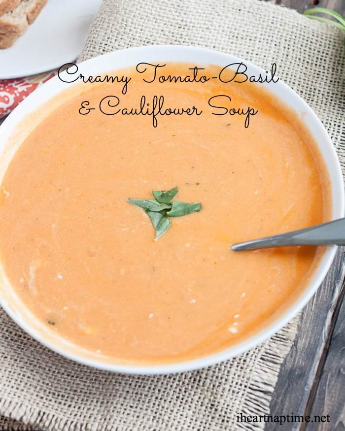 bowl of cauliflower tomato soup with chopped basil on top