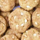 A close up of pumpkin snickerdoodle cookies with white chocolate chips