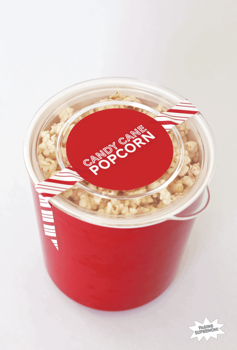 candy cane popcorn in a red bucket with a label