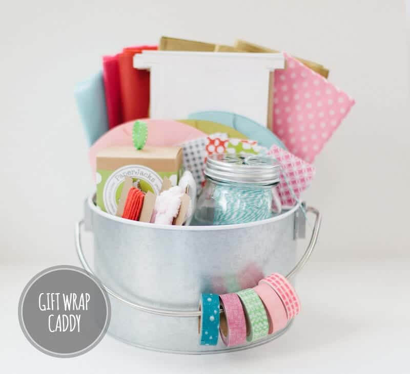 gift wrapping supplies in a tin bucket