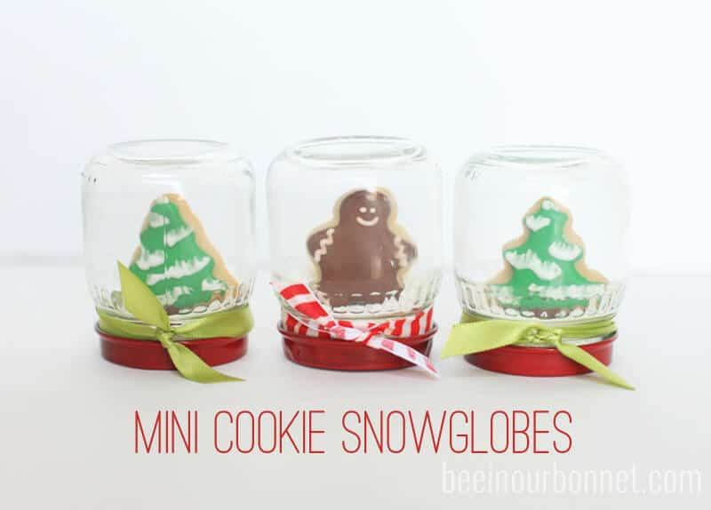mini cookie snow globes sitting on counter