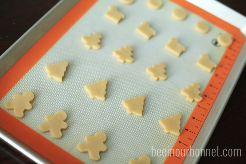 christmas sugar cookie cut outs on baking sheet