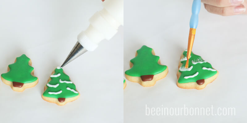 piping frosting on top of christmas sugar cookies