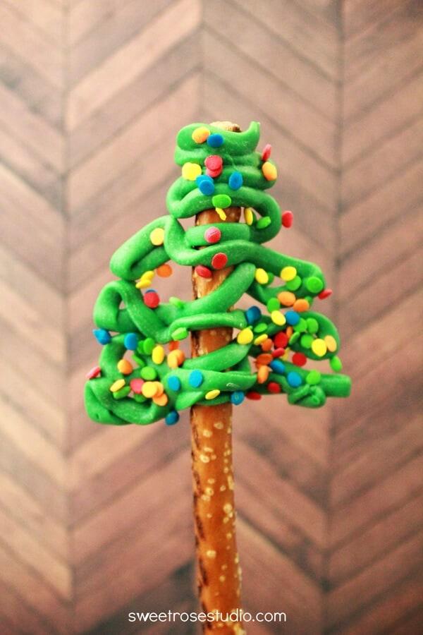 A close up of a christmas tree pretzel rod