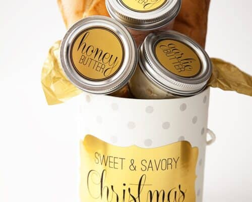 compound butter jars in a christmas box with french bread