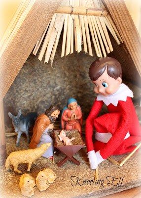 Elf sitting in the nativity