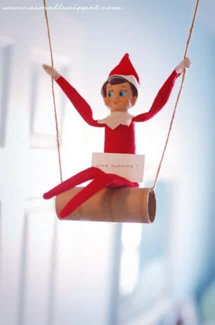 Elf swinging on toilet paper