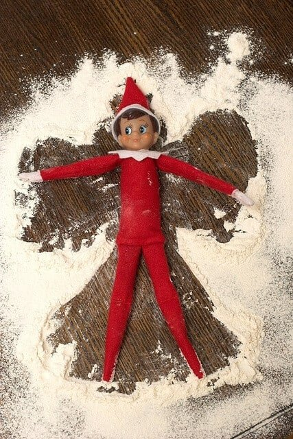 Elf making snow angels