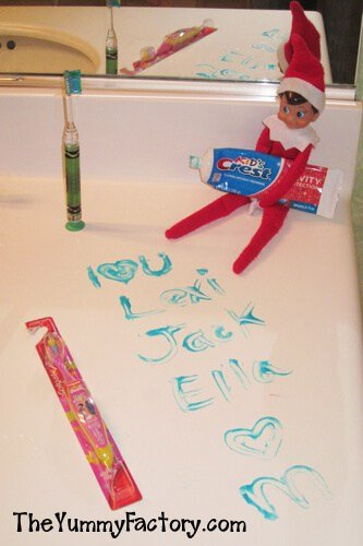 Elf holding tooth paste