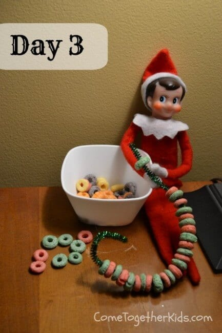 Elf making fruit loop chains