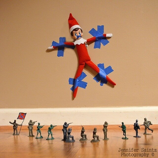 Elf taped to the wall